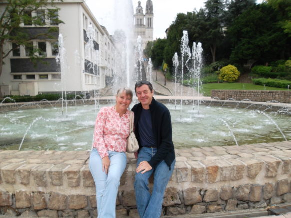 Steve & Jane Hovey sitting on the fountain wall Angers 2012